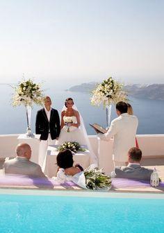 The island of Santorini, Greece is a perfect wedding location. ASPEN CREEK TRAVEL - karen@aspencreektravel.com