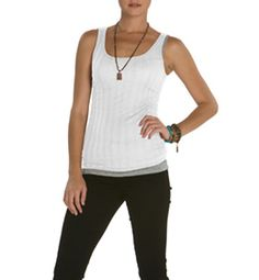 Layer on the tanks this season! You can never have too many tanks and this classic piece in our new ribbed fabric offers unlimited possibilities!