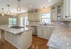 Kitchen done by KHL Design Studio. Light granite, gorgeous pendants, cream cabinets.