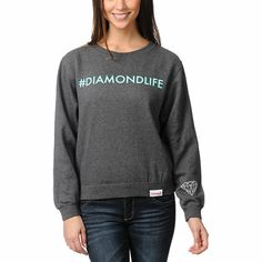 A walking tweet with more style than ever, the Hashtag crew neck is a relaxed fit pullover sweatshirt in a charcoal grey colorway. Featuring a crew neckline, comfortable fit, soft fleece interior, and a #DiamondLife text in bright teal at the front and Di