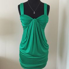 Green Bebe dress✨SALE✨❗️❗️❗️ One of my fave dress! Very cute & sexy silky kinda fabric. 95%Nylon 5% spandex. It says XXS but I usually wear a small around that time so it was still a good fit bebe Dresses