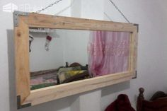 #Bedroom, #LivingRoom, #PalletFrame, #PalletMirror, #PalletWallDecor, #PalletWallHanging, #RecyclingWoodPallets Make your room seem larger on a budget by building an Oversized Rustic Pallet Mirror. The large metal brackets at the mitered corners and large chain give it an industrial edge, while the mitered corners make it look finished. Add a soft whitewash