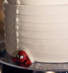 Superhero wedding. Put your fiancé's favorite superhero 'under' the wedding cake.