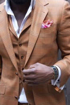 Shop this look on Lookastic:  http://lookastic.com/men/looks/white-dress-shirt-and-tan-vest-and-tan-blazer-and-pink-pocket-square/754  — White Dress Shirt  — Tan Plaid Waistcoat  — Tan Plaid Blazer  — Pink Pocket Square