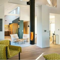 Sleek, modern and minimalist, the Slimfocus suspended fireplace is perfect for smaller spaces and a highly efficient slow-combustion wood heater. Design Moderne, Deco Design, Suspended Fireplace, Architecture Design, Modern Fireplace, Contemporary Fireplaces, Home Remodeling Diy, Urban Loft, Loft House