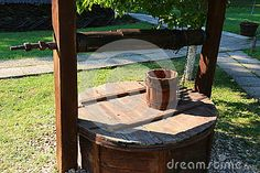 Photo about Old wooden bucket fountain - wooden bucket and lid. Image of handmade, summer, well - 77204800