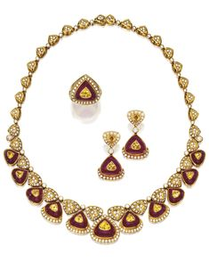 18 KARAT GOLD, RUBY, DIAMOND & YELLOW SAPPHIRE SUITE, HARRY WINSTON. The necklace set at the front with 11 cabochon rubies, each centered by a yellow sapphire, accented throughout with numerous round & pear-shaped diamonds; the earrings of similar design, the two cabochon rubies centered by a yellow sapphire, set with numerous round diamonds; the ring set with a cabochon ruby centered by a yellow sapphire, framed & accented by numerous round diamonds; all with maker's marks for Harry Winston.