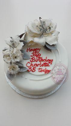 Flower decorated birthday cake Www.sweetdiamondcakes.co.uk