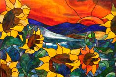 Sunflower rising stained glass window.
