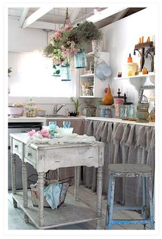 This is adorable... would be a great Tiny Kitchen... use small piece of furniture for island - and - do NOT use pre-made cabinets as they take up too much space... instead use shelving and them drape with burlap = beautiful and charming :)