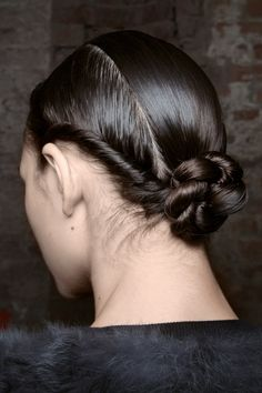 Next-level, twisted chignon seen at J. Mendal F/W 15