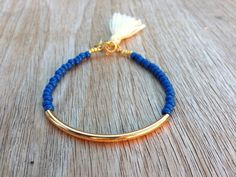 Gold tube bracelet, Beaded Bracelet, beaded bangle, tassel bracelet, Friendship bracelet, seed beads bracelet, seed beads bangle, blue beads by Haneelove on Etsy https://www.etsy.com/listing/154776443/gold-tube-bracelet-beaded-bracelet