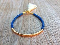 Gold tube bracelet, Beaded Bracelet, beaded bangle, tassel bracelet, Friendship bracelet, seed beads bracelet, seed beads bangle, blue beads by Haneelove on Etsy https://www.etsy.com/listing/154776443/gold-tube-bracelet-beaded-bracelet