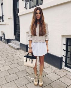 7 chic fashion blogger outfits to copy from this week's best Instagrams: Negin Misralehi wears a sweater over a dress