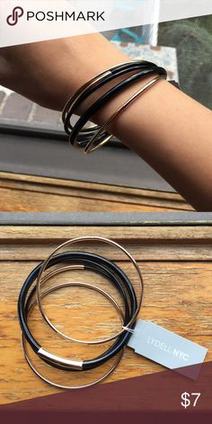 Pack of black bangles Five bangles, three black with gold accents and two gold lydell nyc Jewelry Bracelets