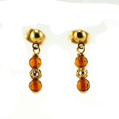 Small Baltic Amber Gold Post Earrings by SleeplessArt on Etsy Made with natural faceted Baltic amber beads and gold plated filigree beads. Everything has been strung on gold plated head pins and hung from gold plated post studs and ear nuts.  13/16 inches long (2.1 cm)  Amber is one of the few varieties of organic gemstones, alongside pearls, coral, and ivory. It is formed through the fossilization of tree resin, and is thousands of years old. Stones has increased in price over recent years…