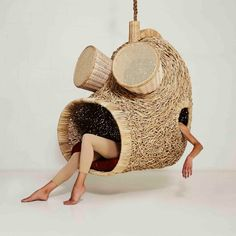 Porky Hefer exhibits human-sized nests made from woven plants stalks