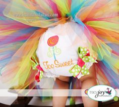 A tulle tutu, tootoo cute! Candyland party theme... TWO sweet candyland party theme for baby turning 2!!! Love this idea!