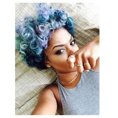 These shimmery aquamarine curls. | 22 Hair Color Ideas For When You Can't Pick Just One