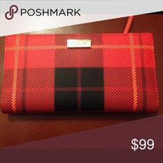 ✨Kate Spade NWT Neda Canterbury Red Plaid Wallet✨ Beautiful, classic, and functional Kate Spade accordion zip wallet! Brand new with tags! ❤️Saffiano leather, zip around closure with gold tone hardware, 12 slots for credit cards and ID, one zip pocket inside for coins, one slip pocket on back, two interior spots for bills. Signature KS satin lining in black and festive red plaid outer. Gorgeous wallet in perfect condition! kate spade Bags Wallets