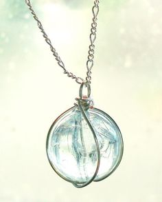 Holy - Sterling silver, aqua crackled glass, final fantasy necklace. $29.00, via Etsy.