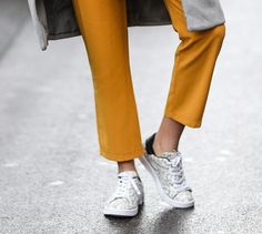 Wear sneakers like a street-style star. High-tops, athletic, platforms or slip-ons. The surprisingly versatile sneaker is the shoe of the season.