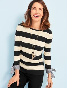 Little details leave a lasting impression on a crewneck sweater with three-quarter sleeves. Woven gingham bow-tie cuffs soften the bold, block stripes. Pair with your favorite denim or black pants for a casual-chic look. | Talbots