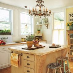 Second-hand pieces like these patina-painted breakfast stools add character to an updated kitchen.