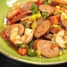 Spicy andouille chicken sausage is simmered in chicken broth with okra, corn, sweet potato chunks, and shrimp for a fast and hearty stew.