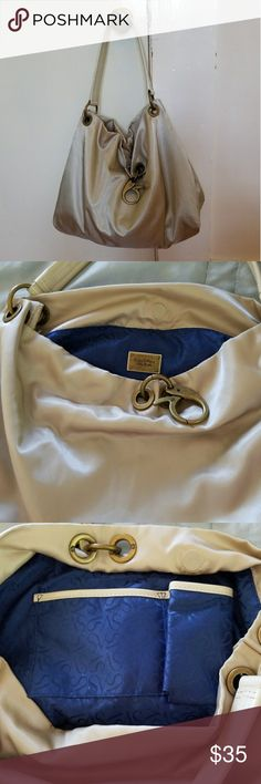 "Simply Vera Vera Wang Nylon Shoulder Bag Stunning Champagne colored nylon shoulder bag!! Large size with 3 inside pockets(zipper intimates, cell phone, cosmetics) brilliant royal blue satin lining, bronze hardware, magnetic closure, large lobster claw key ring, cream patent leather strap 17"", 17""wX13""h, obvious signs of wear (small stains (pic 7,8) but still in good condition!! Simply Vera Vera Wang Bags Shoulder Bags"