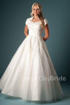 My style of dress! Just enough lace to be fancy yet very elegant. I love the ivory with blonde!