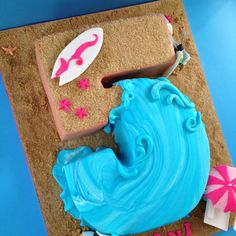 Beach themed cake but with a c instead of a 5