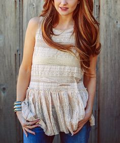Take a look at this Cream Lace Peplum Tank today!