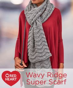 "Wavy Ridge Super Scarf Free Crochet Pattern in Red Heart Yarns -- Simple, but oh so attractive, this over-sized scarf is just what you need to update last year's wardrobe. Ours is 90"" long in a neutral heather, but you can make your Super Scarf any length and any color you desire. This is an easy crochet in a variation of the basic ripple stitch."