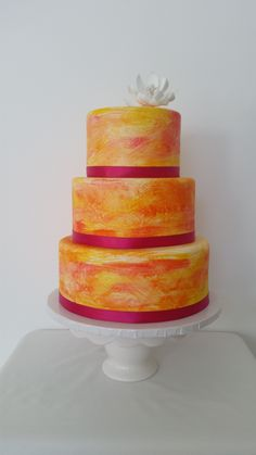Warm orange and yellow tones create a sunrise on this lovely wedding cake. Cupcake Ideas, Custom Cakes, Orange, Yellow, Yummy Cakes, Wedding Cakes, Sunrise, Warm, Baking