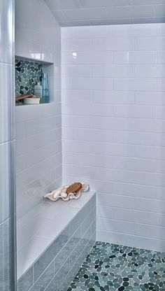Very practical to have a niche for supplies and a bench in the shower. via House of Turquoise: Carla Aston