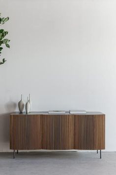 "55""W + 24""D + 26""H INDUSTRIAL STEEL + BIRCH + OAK POLY + OIL FINISH //CUSTOMIZE THIS PIECE This Credenza is Custom Made in Los Angeles. A steel sheet is sheered and adhered to a substrate. The wood is"