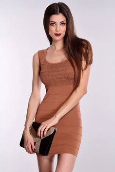 This simple yet so stylish dress is a must have. You can either dress up or dress down this dress. Its perfect for any occasion. It features scoop neck, sleeveless, ribbed, shimmery fabric, open back, and tight fitted. Model is wearing a small. 48% Rayon 36% Nylon 16% Lurex