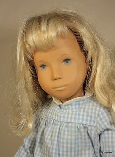 A vintage 1968 Frido (Trendon) manufactured Sasha doll wearing original Gingham fashion.  This doll was imported to the United States and distributed by American toy firm Creative Playthings.