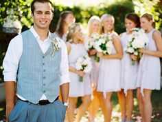 Like this 'pose' for the groom ~ with the pretty ladies off in the background. Photography by