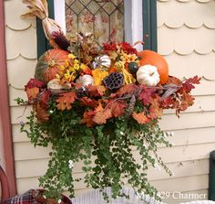 autumn fall window box with pumpkins