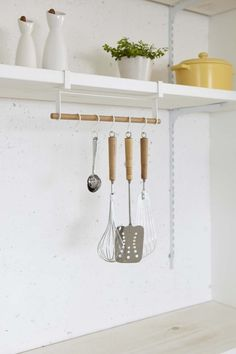 An easy-to-install, under-shelf tool hanging system. | 31 Awesome And Inexpensive Things You Need For Your Kitchen