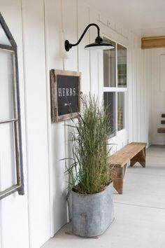 Classic gooseneck fixtures provide light and a casual farmhouse style to this enviable porch! 47 Rustic Farmhouse Porch Decorating Ideas to Show Off This Season Farmhouse Outdoor Decor, Farmhouse Front Porches, Rustic Farmhouse, Farmhouse Style, Front Porch Bench, Front Porch Lights, Farmhouse Landscaping, Farmhouse Garden, Rustic Style