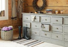 Cool dresser color and planked wall.