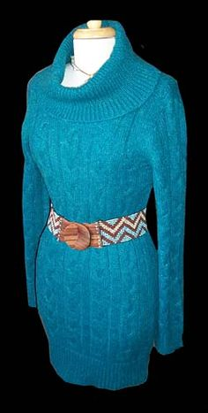 Teal Sweater Dress-Cozy, touchable, and beyond soft! This sweater dress is just waiting for a great pair of riding boots, and leggings! From the deep teal color, to the cable knit softness you just can't go wrong.     35 inches long. 60% Acrylic, 25% Nylon, and 15% Wool. Machine wash cold, lay flat to dry.    $46