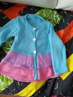 Violet's little frilled cardigan.