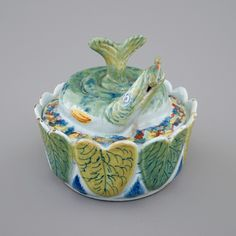 A Dutch Delft polychrome butter tub
