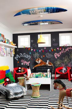 Domaine Home - boy's rooms - playroom, kids playroom, chalkboard paint, chalkboard wall, chalkboard accent wall, black and white striped rug...