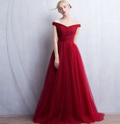 Red Floor Length Tulle Wedding Gown Featuring Off-The-Shoulder