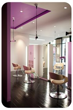 Ditch the purple! Digging the hanging hair dryers that match the purple on the ceiling (and of course those Curved-Art chairs! Home Hair Salons, Natural Hair Salons, Hair Salon Interior, Spa Interior, Salon Interior Design, Beauty Salon Design, Restaurants, Ceiling Installation, Salon Business